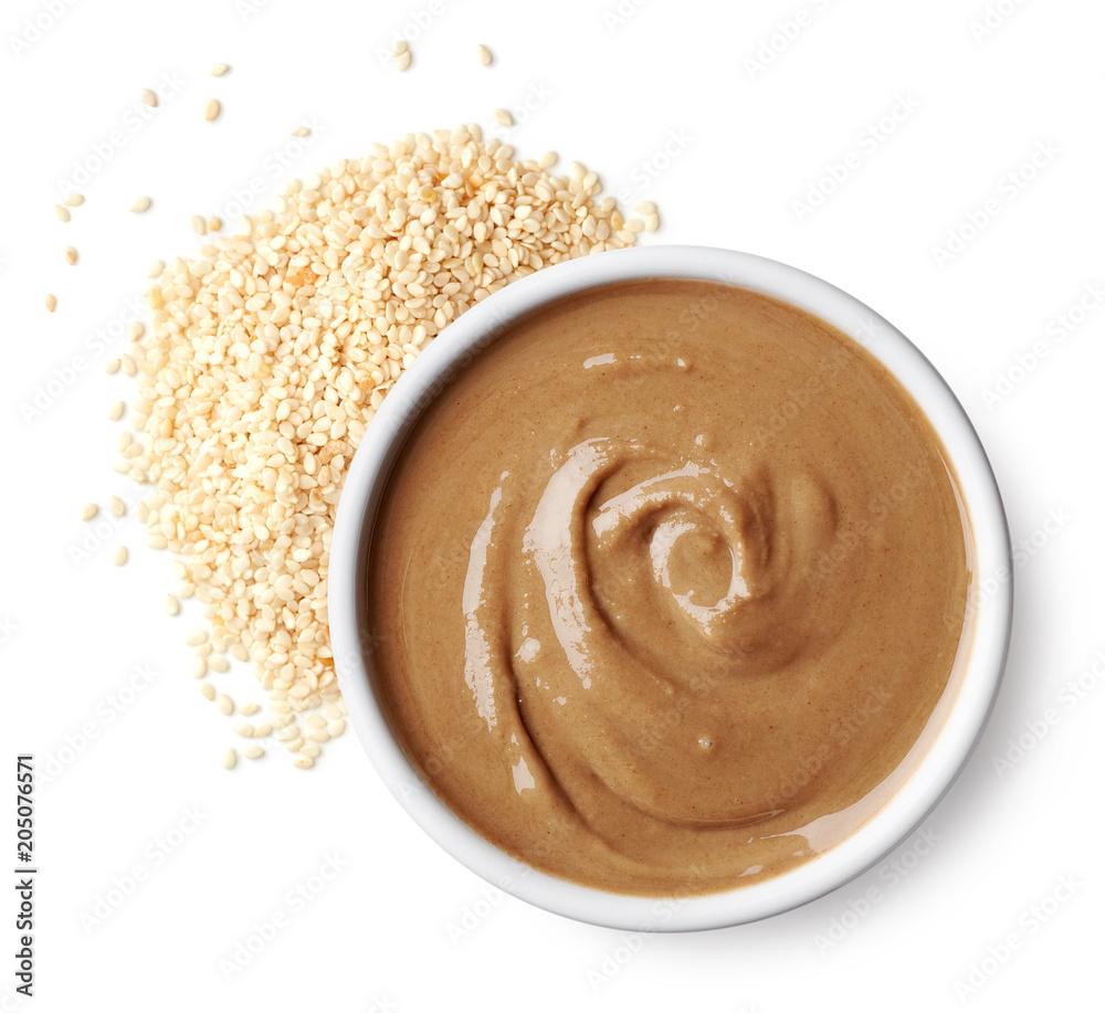 Fototapety, obrazy: Bowl of tahini sauce and sesame seeds