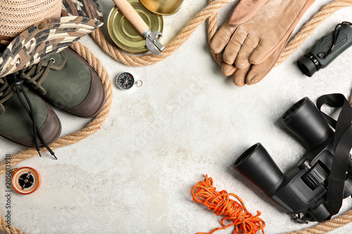 Flat lay composition with camping equipment on light background Fototapeta