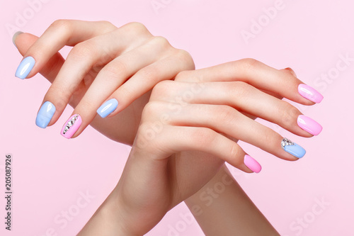Printed kitchen splashbacks Manicure Beautiful pink and blue manicure with crystals on female hand. Close-up. Picture taken in the studio