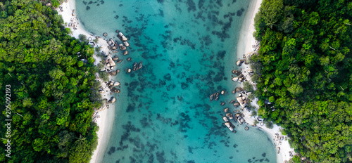 Foto op Plexiglas Luchtfoto aerial view of pano with rainforest near the rocky beach and turquoise shore