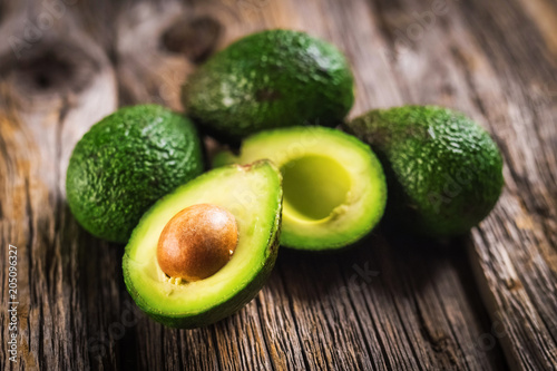 Avocados on wooden background