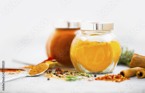 Foto op Canvas Aromatische Aromatic spices in jars. Turmeric powder in a jar