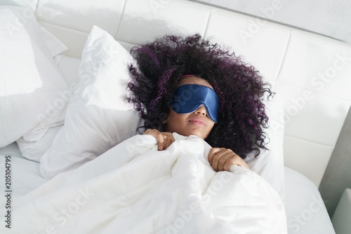 Fotobehang Stof Tired Black Girl Waking Up In Bed With Sleep Mask
