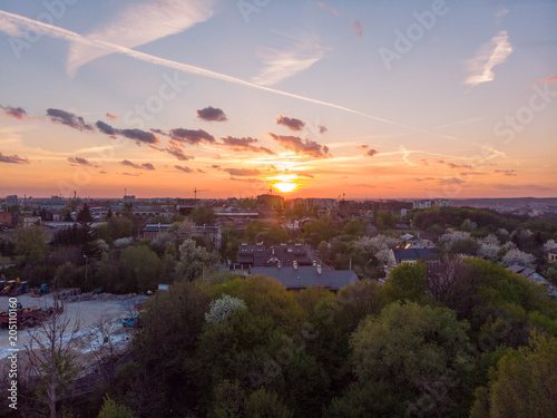 Fototapety, obrazy: orange sunset above city. aerial view. tree crowns