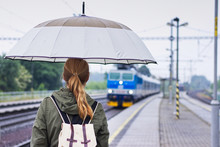 Backpacker Woman With Umbrella...