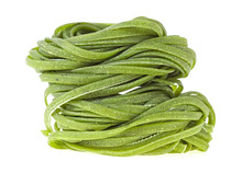 Two Nests Of Green Tagliatelle Isolated On White Background