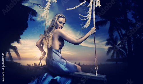 Foto op Plexiglas Artist KB Portrait of a charming blonde sitting on a swing