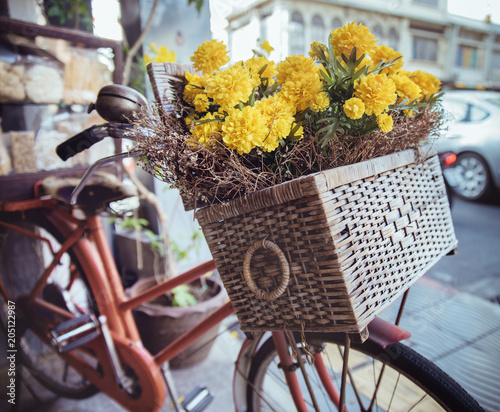 Foto op Plexiglas Artist KB Closeup picture of a vintage bike with flowers in a basket