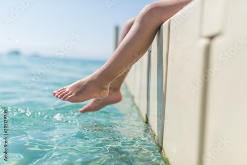 Fototapety, obrazy: Close up of little caucasian child legs near sea water