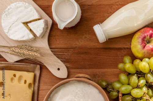 Rustic style tabletop with fruits and dairy products