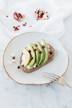 Avocado Sandwich With Cottage Cheese And Pomegranate.