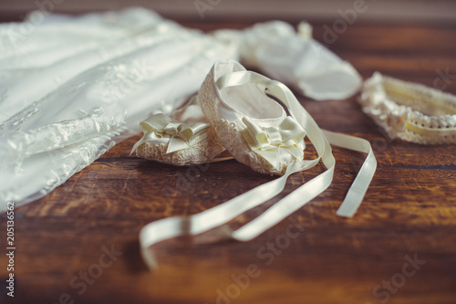 christening baby dress and shoes Fotobehang