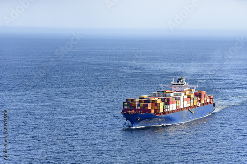 Cargo ship carrying several containers on the waters of the sea of rio de Janeiro, Brazil
