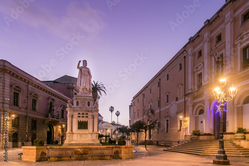 Photo Olbia by Night, statue, lamp post and buldings