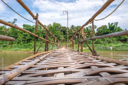 Fotografie, Obraz  Bamboo bridge crossing the Nam Kahn River at its confluence with the Mekong Rive