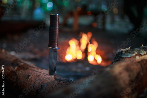 Photo knife in wood by fire