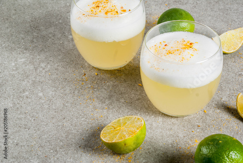 Peruvian, Mexican, Chilean traditional drink pisco sour liqueur, with fresh lime Canvas Print