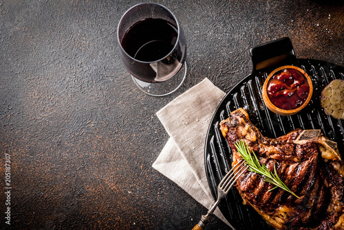 Fotografie, Obraz  Fresh grilled meat beef steak with with red wine, herbs and spices