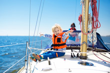 Kids Sail On Yacht In Sea. Chi...