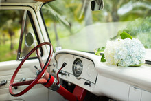 Classic Car Interior With White Flowers Red Steering Wheel