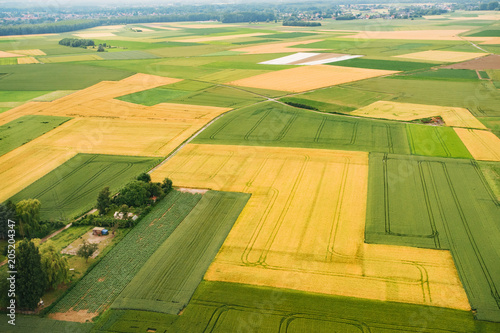 Foto op Aluminium Luchtfoto Bird eye view of land farmland and nature landscape. Aerial photography of agriculture fields in countryside.