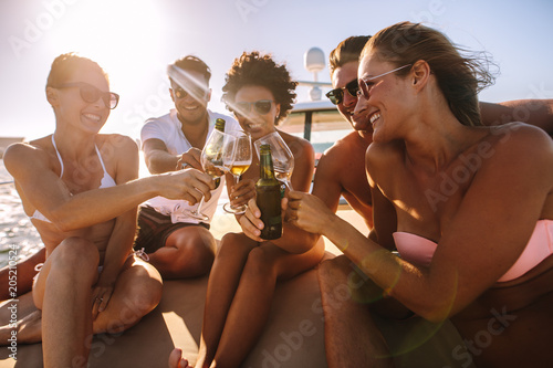 Multi-ethnic friends partying on a boat