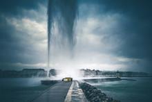 Geneva Fountain Under The Rain In Geneva City Center, Switzerland.