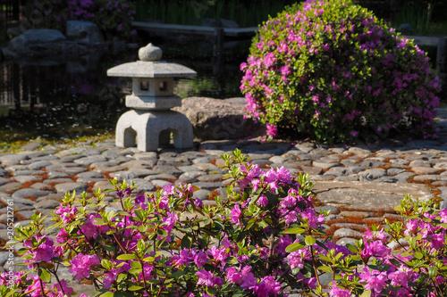 Stone lantern in a Japanese garden. Blurred focus. Poster