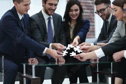 Fotobehang Stof Business team solving puzzle together.