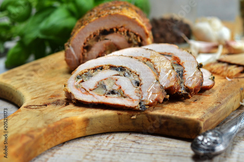 Pork roulade on wooden board Wallpaper Mural