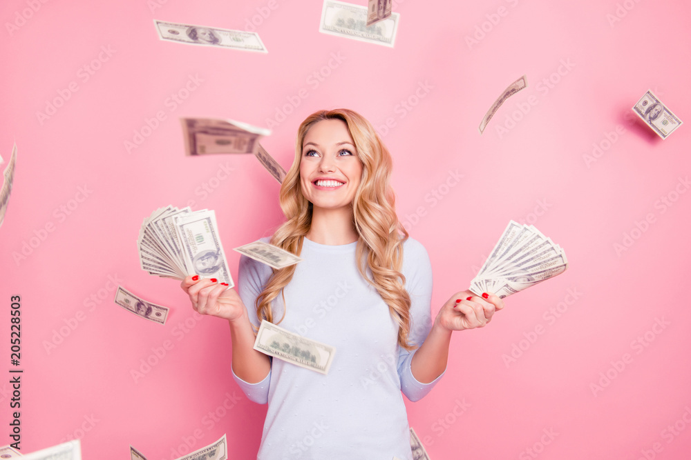 Fototapety, obrazy: Portrait of pretty charming positive cute successful lucky cheerful girl standing under shower from money having a lot of money in hands isolated on pink background