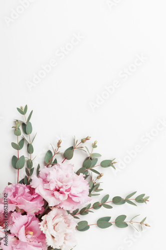 Foto op Canvas Bloemen Pastel flowers and eucalyptus leaves on white table top view. Flat lay style.