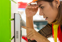 Female Employees Are Pressing The Code To Unlock The Door.