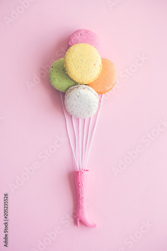 Canvas Prints Textures Doll boot with bunch of multicolored macarons as balloons abstract.