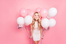 Portrait Of Positive Elegant Girlfriend In White Dress Having Many White Air Balloons Around Her Looking At Camera Isolated On Pink Background
