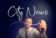 A businessman writing a City News concept with a white pen on a clear screen.