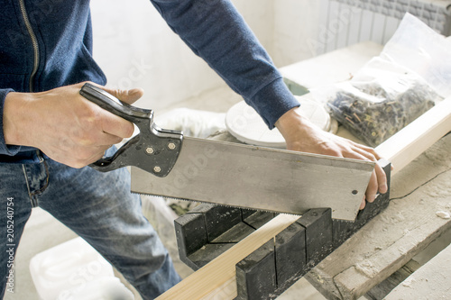Fotografie, Obraz  saws with a knife at the corner with the device, wood hacksaw