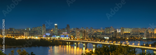 Poster Kiev Panorama of Kiev city at night. Kyiv Left bank skyline with Paton bridge over Dnieper river