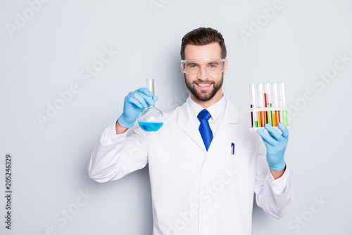 Cuadros en Lienzo Portrait of cheerful handsome scientist with bristle in white lab coat, tie, pro