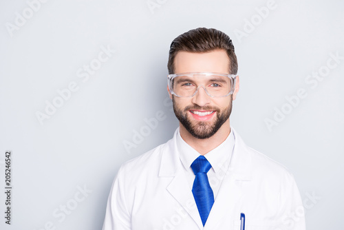 Valokuva  Portrait of stylish positive scientist with hairstyle in white outfit with tie i