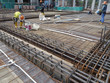 Steel reinforcement bar and timber formworks at construction site. Be part of the reinforced concrete structure. It is tied together using tiny wire before pouring the concrete.