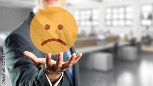 Valokuva  Geschäftsmann präsentiert traurigen Smiley