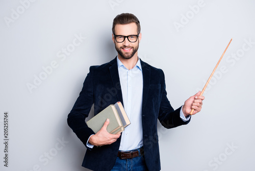 Obraz na plátně Portrait of cheerful teacher with stubble in shirt jacket, having books in hand