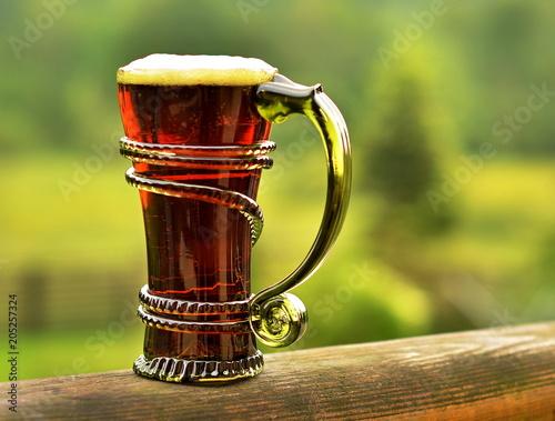 Foto op Plexiglas Bier / Cider half dark beer in a vintage artistic green glass