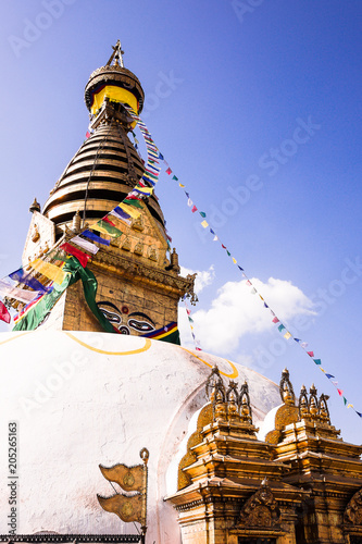 Swayambhunath (monkey temple) stupa in Kathmandu, Nepal. Ancient religious architecture atop a hill in the Kathmandu Valley, west of Kathmandu city. Image with copy space.