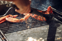 Lobster Grilled Barbecued Seafood In BBQ Flames.