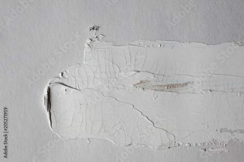 grey brush stroke on gray wall