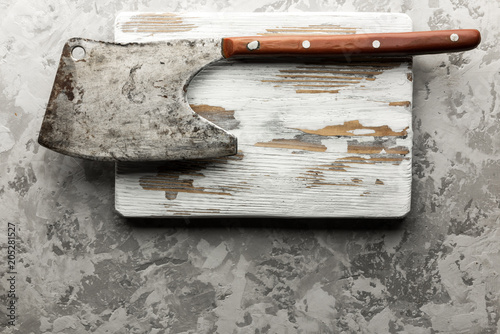 Fototapety, obrazy: Old rustic axe for meat on a wooden board on grunge background. Food photography