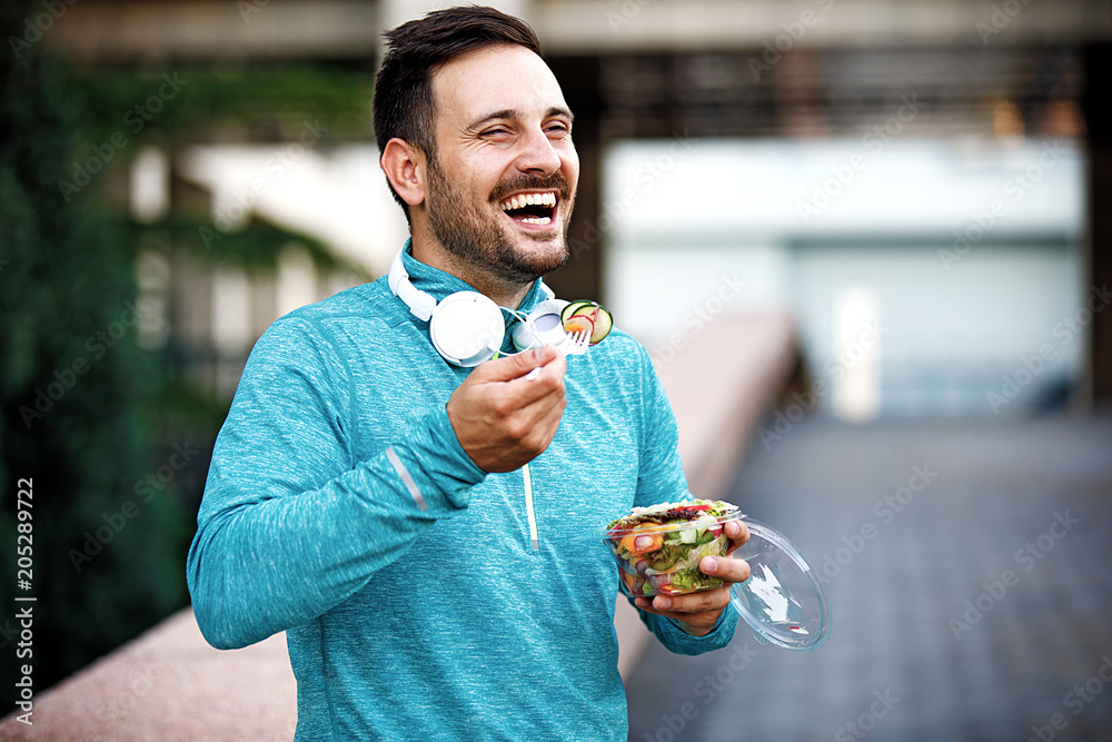 Fototapety, obrazy: Man is eating vegetable salad
