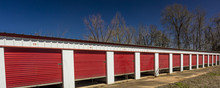 MARCH 6, 2018 - Self Storage Warehouse With Open Red Doors Outside Marshall - Texas Americana